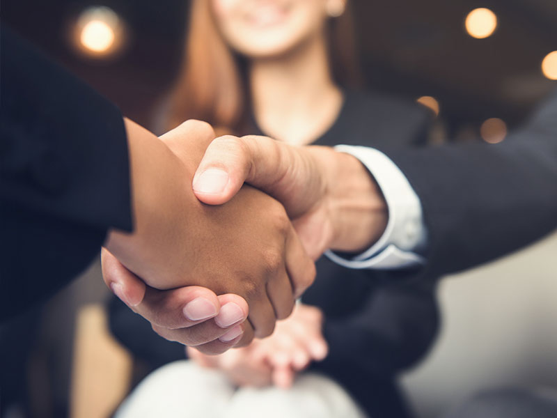 Brisbane outsourced professionals shaking hands